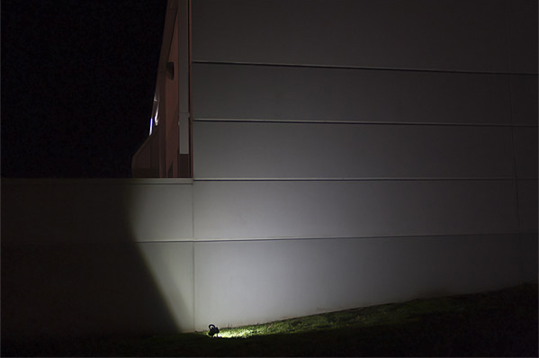 10W-Portable-Rechargeable-LED-work-light-on-building-wall-compared-after